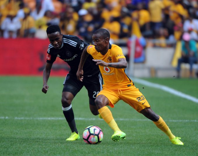 Joseph Molangoane of Kaizer Chiefs is challenged by Thembinkosi Lorch of Orlando Pirates   during theAbsa Premiership match between Kaizer Chiefs and Orlando Pirates at FNB Stadium. © Sydney Mahlangu/BackpagePix