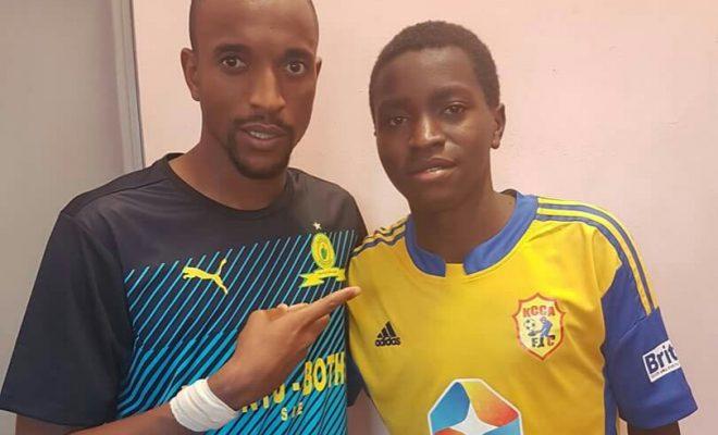 Mamelodi Sundowns midfielder Tiyani Mabunda with KCCA forward  Allan Okello .