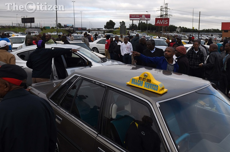 during a protest by meter taxi drivers on the R24 near the Barbara offramp in Edenvale, They blocked the highway that leads to the airport causing massive delays during their protest over the cab hailing app, UBER. Picture: Neil McCartney