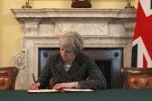 Theresa May takes pot-shot at plotters