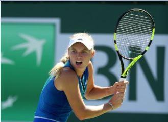 Caroline Wozniacki believes Maria Sharapova needs to do the hard yards to get into big tournaments again. Photo: Matthew Stockman/Getty/AFP.