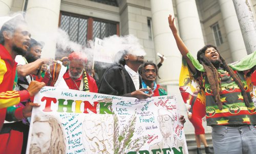 South African advocate Mbonisi Nkita (C) reacts with members of the Rastafarian community after the ruling legalizing Cannabis outside the Cape High Court in Cape Town, South Africa, 31 March 2017.  The Western Cape High Court 31 March 2017 ruled it will allow people to possess, cultivate and use Cannabis at home. The law that made it illegal has been removed. Parliament has 24 months to write it into statute.  EPA/NIC BOTHMA