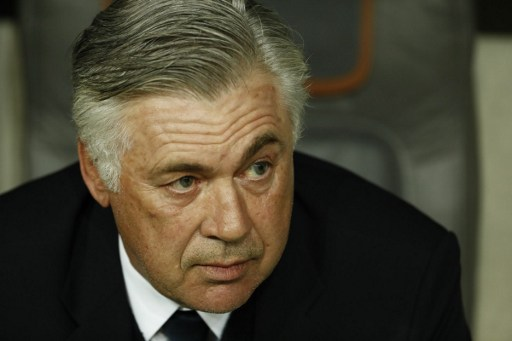 Bayern Munich's Italian head coach Carlo Ancelotti sits on the bench prior to the UEFA Champions League 1st leg quarter-final football match FC Bayern Munich v Real Madrid in Munich, southen Germany on April 12, 2017. / AFP PHOTO / Odd ANDERSEN