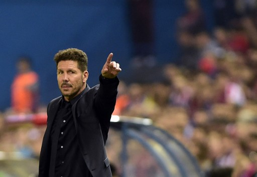 Atletico Madrid's Argentinian coach Diego Simeone  / AFP PHOTO / GERARD JULIEN