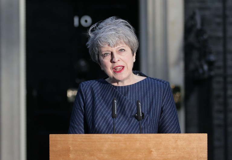 British Prime Minister Theresa May speaks to the media outside 10 Downing Street in central London on April 18, 2017. British Prime Minister Theresa May has called for an early general election. / AFP PHOTO / Daniel LEAL-OLIVAS