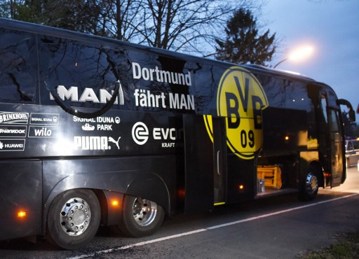(FILES) This file photo taken on April 11, 2017 shows the damaged bus of German first division Bundesliga football club Borussia Dortmund after an explosion some 10km away from the stadium prior to the UEFA Champions League 1st leg quarter-final football match BVB Borussia Dortmund v Monaco in Dortmund, western Germany. According to the public prosecution, a German-Russian man has been arrested on April 21, 2017 in southern Germany in connection with the bomb attack on Dortmund's team bus. The bus was hit by an explosives attack when it was en route to the stadium in Dortmund for the Champions League quarter-final, first-leg football match against Monaco on April 11, 2017. / AFP PHOTO / Patrik STOLLARZ