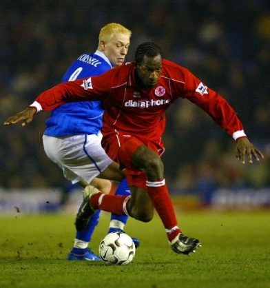 (FILES) This file photo taken on March 3, 2004 shows Ugo Ehiogu (R) of Middlesborough passing Birmingham City's Mikael Forssell during the Premiership football match at St. Andrews in Birmingham. Former England international Ugo Ehiogu has died after suffering a suspected heart attack at the age of 44, Tottenham Hotspur have confirmed on April 21, 2017. / AFP PHOTO / ADRIAN DENNIS