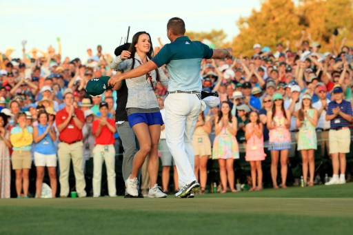 The embrace that caused all the trouble. Sergio Garcia is congratulated by his fiancee, Angela Akins. Photo: Andrew Redington/Getty Images/AFP.