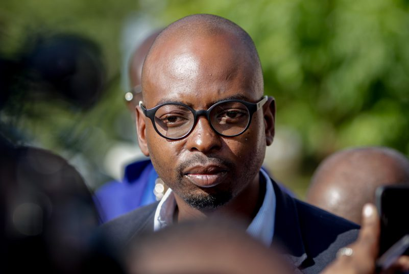 Zakhele Mbhele, the DA shadow Minister of Police, speaks to the press outside the Hawks offices in Silverton, Pretoria. The DA picketed outside the Hawks offices in protest of Berning Ntlemeza's return to work as head of the Hawks despite the High Court Judgement against him. Photo by Yeshiel Panchia