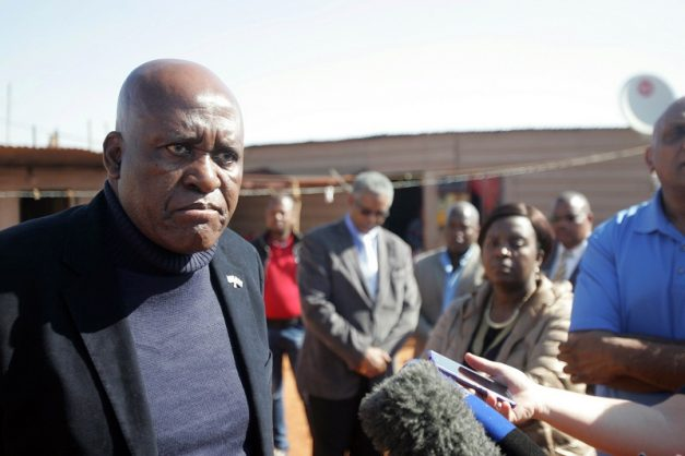 JOHANNESBURG, SOUTH AFRICA – AUGUST 14: Former Hawks boss; Berning Ntlemeza visits the family where four members were shot and killed at the Lawley informal settlements on August 14, 2016 in Johannesburg, South Africa. A family of four was brutally murdered on Saturday, August 14, after an alleged gang entered their house in Lawley. The owner of the house was also shot but survived. (Photo by Gallo Images / Sowetan / Antonio Muchave)