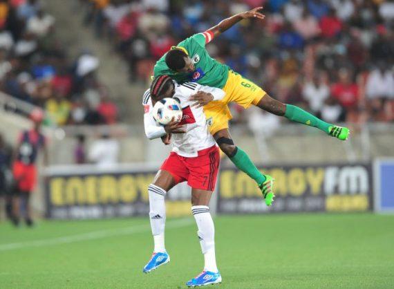 Tendai Ndoro of Orlando Pirates challenged by Dineo Shaku of Baroka FC during the Absa Premiership match between Baroka FC and Orlando Pirates. (Samuel Shivambu/Backpagepix)