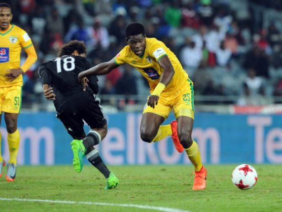 Issa Sarr of Orlando Pirates challenges Nyasha Munetsi of Baroka FC during the Absa Premiership match between Orlando Pirates and Baroka FC at Orlando Stadium. (Sydney Mahlangu /BackpagePix)