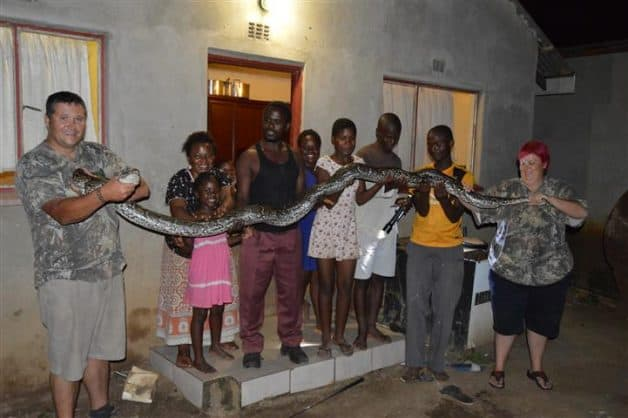 Fanie with residents and the massive Python