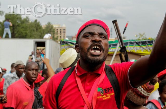 An EFF member gestures angrily towards the police line  during the Day Of Action march - a civil society and opposition party protest to Union Buildings, Pretoria, against the presidency of Jacob Zuma. Picture: Yeshiel Panchia