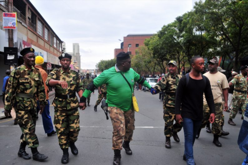 MKMVA members and Luthuli House security move to assist police in creating a cordon preventing ANCYL members attacking returning DA marchers on 07 April 2017 in Johannesburg, South Africa. (Photo by Gallo Images / Dino Lloyd)