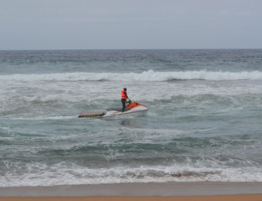 Emergency services are searching for the body of the young man who drowned at Salmon Bay beach this morning.