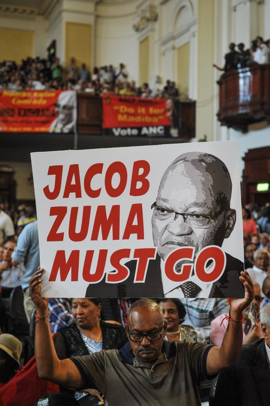 Some of the hundreds of South African Communist Party members and supporters hold anti-Zuma banners and posters during the late Anti Apartheid activist Ahmed Kathrada's memorial service at the Johannesburg CIty Hall on April 1, 2017 in Johannesburg. Picture: Jacques Nelles