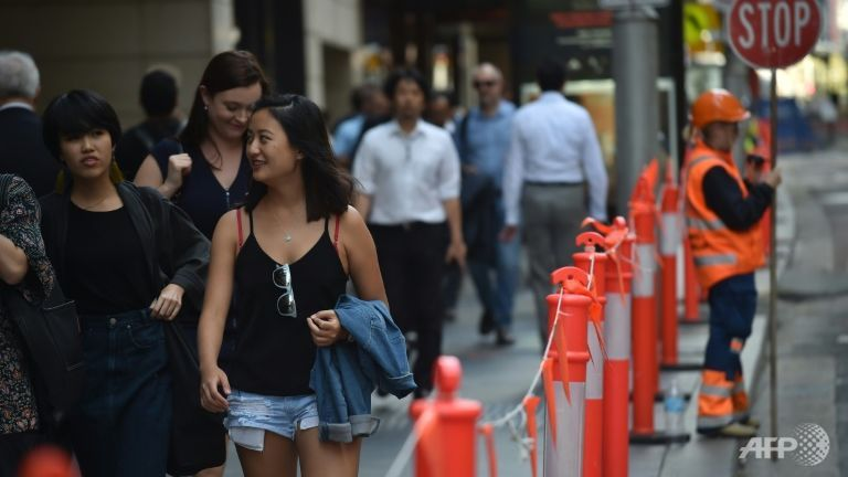 Pedestrians in Sydney's central business district on Apr 19, 2017. Australia's decision to scrap a visa programme for temporary foreign workers won both praise and criticism. (Photo: AFP/Peter Parks)