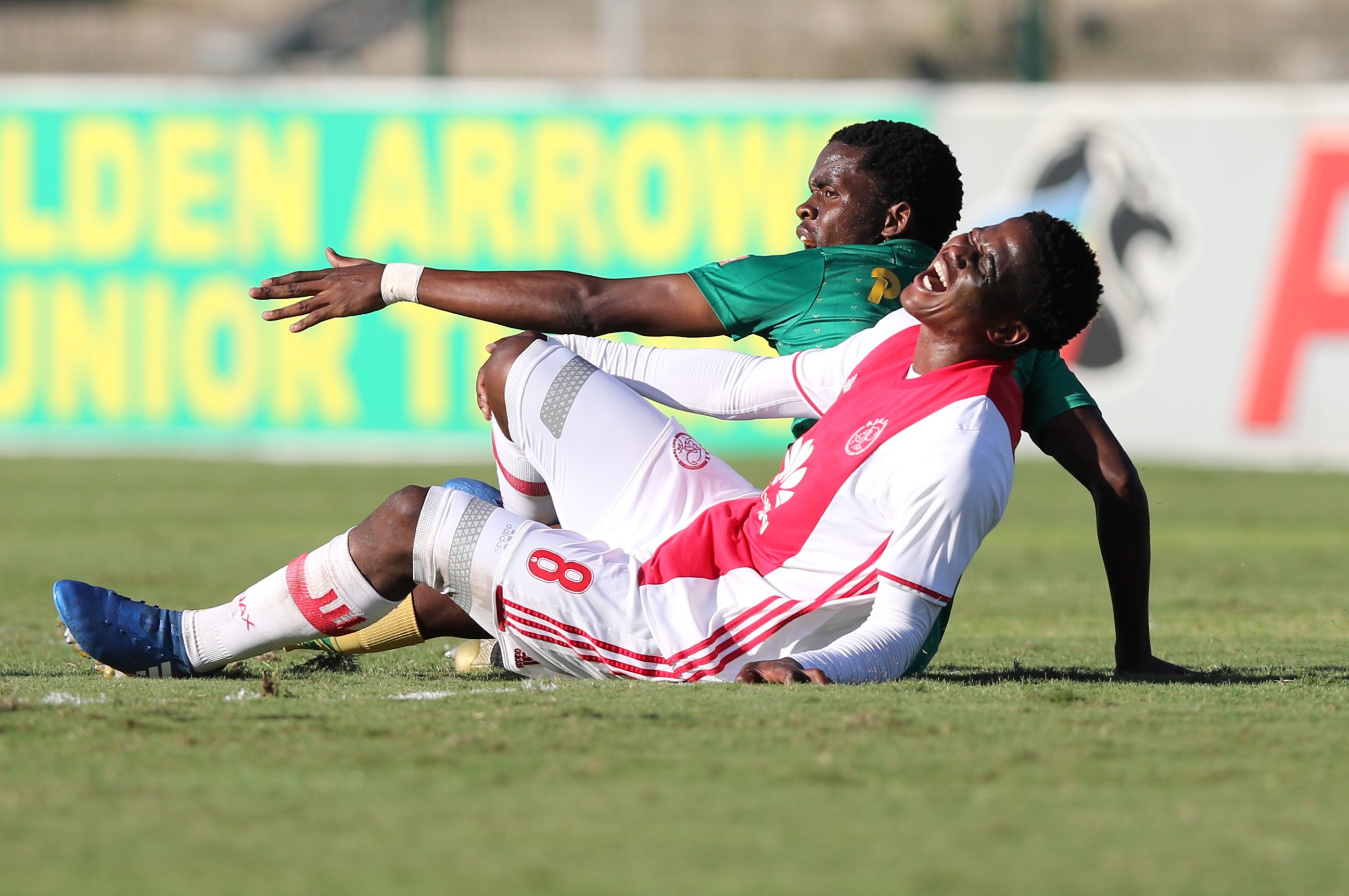 DURBAN, SOUTH AFRICA - APRIL 15: Danny Phiri of Golden Arrows fouls Ndiviwe Mdabuka during the Absa Premiership match between Golden Arrows and Ajax Cape Town at Prince Magogo Stadium on April 15, 2017 in Durban, South Africa. (Photo by Photo by Anesh Debiky/Gallo Images)
