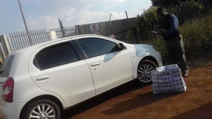 KEMPTON SAPS spokesperson, Capt Jethro Mtshali, nex to the abandoned vehicle on Fitter Road.