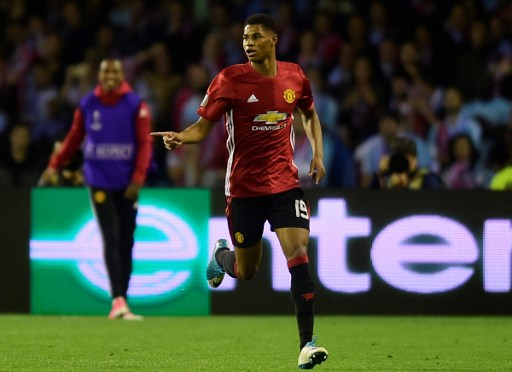 Manchester United's forward Marcus Rashford celebrates after scoring the opener during their UEFA Europa League semi final first leg football match RC Celta de Vigo vs Manchester United FC at the Balaidos stadium in Vigo on May 4, 2017. Manchester won 1-0. / AFP PHOTO / MIGUEL RIOPA