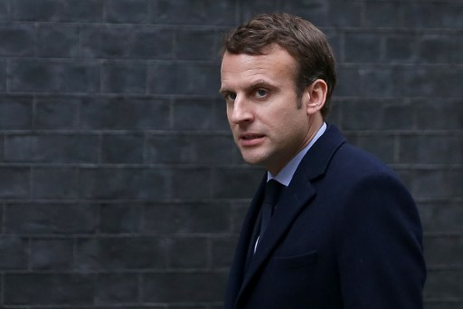 """(FILES) This file photo taken on February 21, 2017 shows French presidential election candidate for the En Marche ! movement Emmanuel Macron, arriving outside 10 Downing Street in central London, ahead of his meeting with British Prime Minister Theresa May.  Incoming French President Emmanuel Macron will hold a """"tough"""" line during Brexit negotiations but will not seek to """"punish"""" Britain, his chief economic adviser said on May 8, 2017. Macron, who campaigned on a pro-EU platform, has previously called Brexit a """"crime"""" and said that Britain should continue paying into the EU budget if it wants access to the European single market. / AFP PHOTO / Daniel LEAL-OLIVAS"""