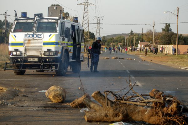 A police Nyala guards a corner while protesters keep their distance after confrontations between residents and police in Ennerdale, Johannesburg. Residents in the area continued protests today against poor service delivery and lack of housing, which led to confrontations with police. 11 May 2017. Picture: Yeshiel Panchia