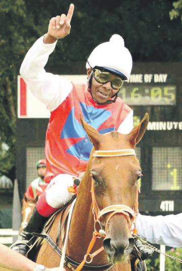 WINNING CHEER. Samuel Mosia winning on Goodness Me in the second leg of the Work Riders' Challenge at the Vaal in January. Mosia tops the log ahead of Leg 3 at Turffontein tomorrow and will be looking to win the Challenge for the second successive year.