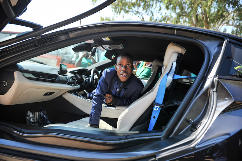 """Prophet Paseka """"Mboro"""" Motsoeneng speaks to his body guard from inside his BMW i8 during the official launch of the Molo Makhelwane campaign in Hammanskraal, 5 May 2017. Picture: Jacques Nelles"""