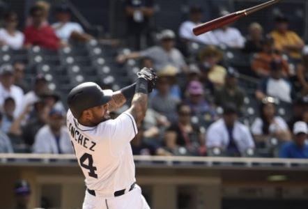 Hector Sanchez loses control of his bat. Photo: Denis Poroy/AFP.