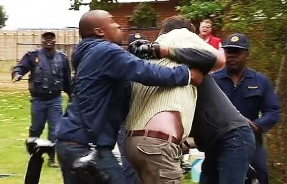 A man attacks a journalist who was covering the Coligny. case on Monday. Image: eNCA