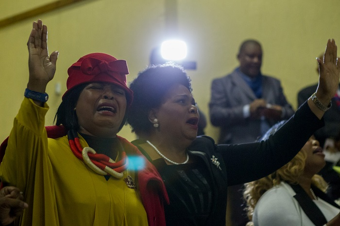 Mourners cry during the funeral service of Karabo Mokoena in Diepkloof Community Hall in Soweto on 19 May 2017.  Mokoena was killed and burnt, allegedly by her boyfriend, in a murder that shocked the country and catalysed debate around gender based violence. Picture: Yeshiel Panchia
