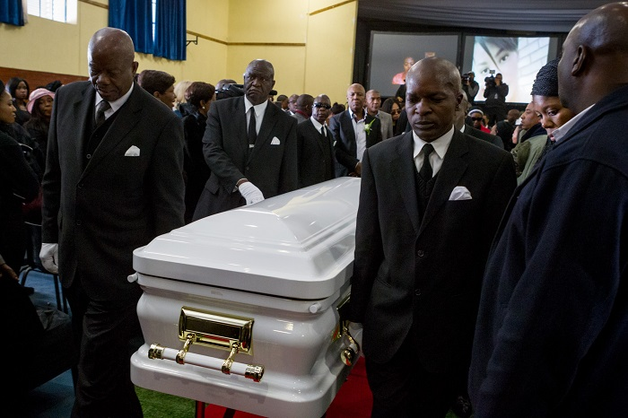 Pallbearers carry the casket of Karabo Mokoena out of the Diepkloof Community Hall in Soweto during her funeral service on 19 May 2017. Mokoena was killed and burnt, allegedly by her boyfriend, in a murder that shocked the country and catalysed debate around gender based violence. Picture: Yeshiel Panchia