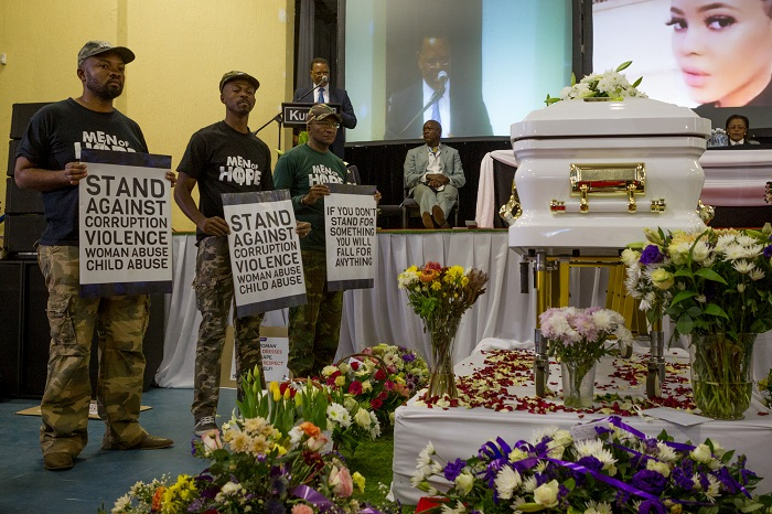 Men against violence toward women stand alongside Karabo's coffin during her funeral service in the Diepkloof Community Hall in Soweto on 19 May 2017.  Mokoena was killed and burnt, allegedly by her boyfriend, in a murder that shocked the country and catalysed debate around gender based violence. Picture: Yeshiel Panchia