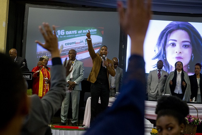 Pastor Neyi Zimu encourages the crowd during the funeral service of Karabo Mokoena in Diepkloof Community Hall in Soweto on 19 May 2017.  Mokoena was killed and burnt, allegedly by her boyfriend, in a murder that shocked the country and catalysed debate around gender based violence. Picture: Yeshiel Panchia
