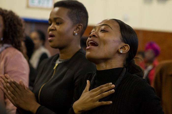 A mourner cries during the funeral service of Karabo Mokoena in Diepkloof Community Hall in Soweto on 19 May 2017.  Mokoena was killed and burnt, allegedly by her boyfriend, in a murder that shocked the country and catalysed debate around gender based violence. Picture: Yeshiel Panchia