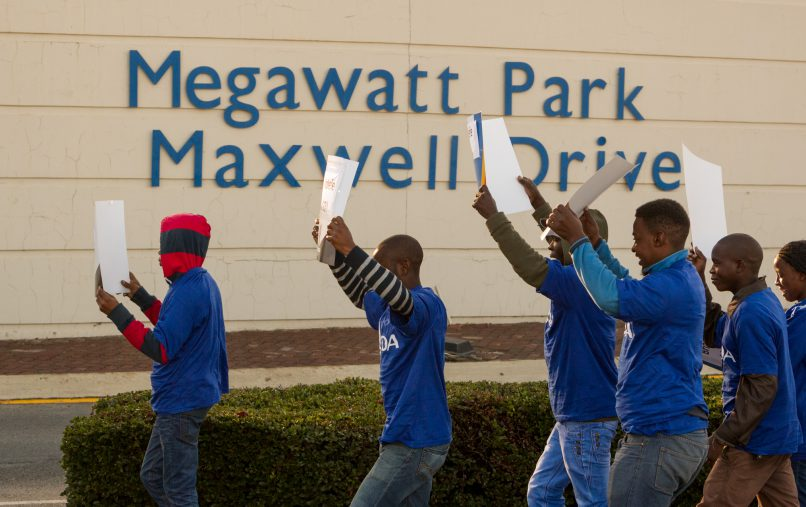 Protestors from the DA march past and carry placards Megawatt Park in Sunninghill, Johannesburg. Members of the DA, COPE and some private citizens protested the reinstatement of Brian Molefe as CEO of Eskom, who resigned under a cloud of suspicion earlier this year. 15 May 2017. Picture: Yeshiel Panchia