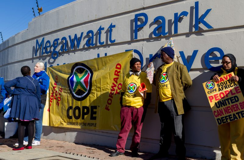 Protestors from COPE and DA hold placards and sing outside Megawatt Park in Sunninghill, Johannesburg. Members of the DA, COPE and some private citizens protested the reinstatement of Brian Molefe as CEO of Eskom, who resigned under a cloud of suspicion earlier this year. 15 May 2017. Picture: Yeshiel Panchia