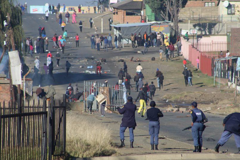 Police fire-off rubber bullets at angry protesters.