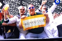 PIC: White dude holds 'Zuma se po*s' placard on TV in Paris
