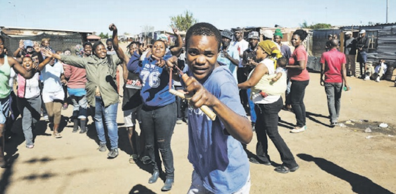 CATAPULT PROTEST. Residents of Soshanguve Block KK during a service delivery protest in Pretoria yesterday, demanding electricity and housing. Picture: Jacques Nelles