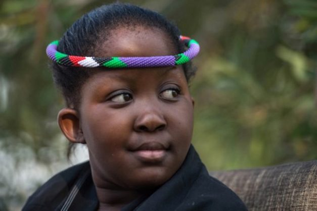 Masalanabo Modjadji, 12, South Africa's only female traditional ruler, with claims of mystical rainmaking powers, is pictured at her home in Midrand on April 24, 2017 in South Africa.  Queen Modjadji is the hereditary ruler of the Balobedu, an ethnic tribe in South Africa's northern province of Limpopo. She will be formally crowned when she turns 18, having ascended to the throne as an infant when the previous queen, her mother, died in 2005.  / AFP PHOTO / MUJAHID SAFODIEN