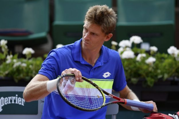 Kevin Anderson grudgingly puts his racket away after getting injured again. Photo: Lionel Bonaventure/AFP.