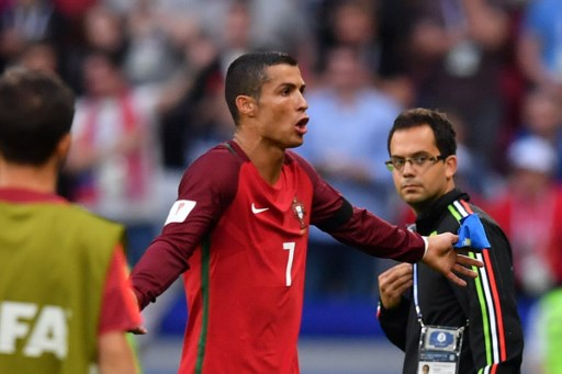 Portugal's forward Cristiano Ronaldo reacts after during the 2017 Confederations Cup group A football match between Portugal and Mexico at the Kazan Arena in Kazan on June 18, 2017. / AFP PHOTO / Yuri CORTEZ