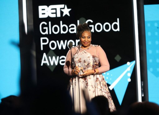 LOS ANGELES, CA - JUNE 24: Honoree Yvonne Chaka Chaka (R) accepts the Global Good Power Award onstage at the BET International Awards Presentation at Microsoft Theater on June 24, 2017 in Los Angeles, California.   Frederick M. Brown/Getty Images for BET/AFP