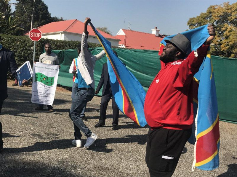 Scores of DRC nationals protest at the main entrance of the Sefako Makgatho presidential guesthouse in Pretoria as President Jacob Zuma hosted visiting DRC President Joseph Kabila. Picture: ANA