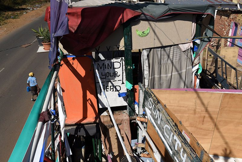 One of the rooms, named Sun City, is seen in Johannes's home. Johannes lives here with his wife, Lillian, and two others that live in small sub divided shacks in the back of the property.