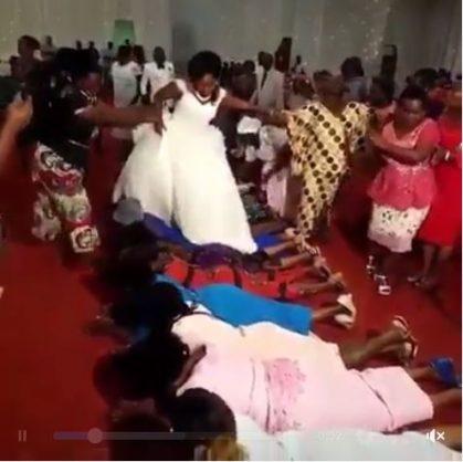 Pastor's wife walks over congregants.