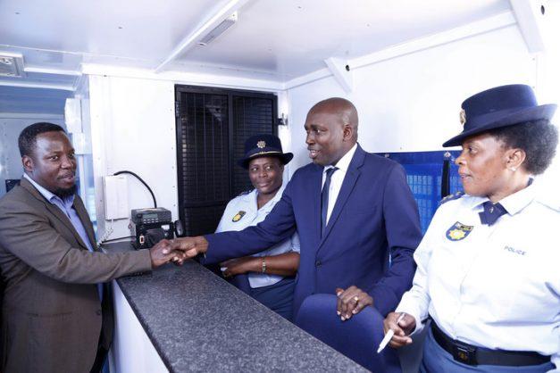 INkosi Mabhudu Tembe and MEC Mxolisi Kaunda shake hands after the opening of KwaSkhemelele Satellite Police Station, while two police officers look on. Picture: Zululand Observer