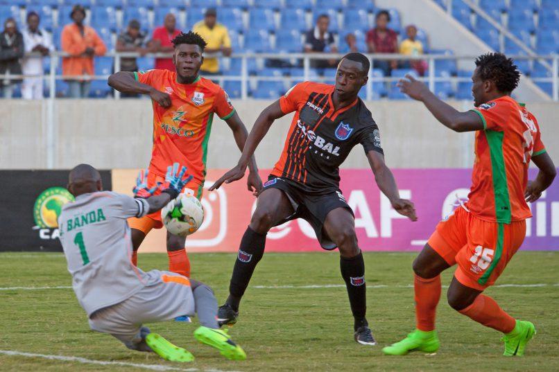 Mamadou Diawara of Clube Recreativo Desportivo do Libolo tries to nick the ball off Zesco United goalkeeper Jacob Banda as David Odiambo and Fackson Kapumbu offer the goalkeeper protection